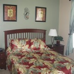 "Queen Master Suite - Queen-size bed with a 32"" Plasma TV and an adjacent full bath"