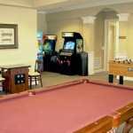 The game room features a video arcade and billiard tables